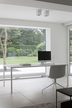 Minimal with the Catifa 46 Chair http://www.nest.co.uk/search/arper-catifa-46-leather-chair-trestle-base
