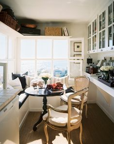 Breakfast Nook. Yes. Please. I also love the shelving above the windows. and the built in benches...and the little black table....and, and, and.