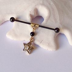 Industrial Barbell - Brass Wire Wrap With Black Onyx and Gold Star Charm Industrial Barbell Piercing by JeweledNavel on Etsy https://www.etsy.com/listing/179782355/industrial-barbell-brass-wire-wrap-with