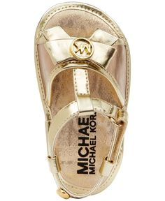 These chic Michael Michael Kors T-straps are a golden choice for the fashion-savvy baby girl. | Synthetic upper; Fabric sole | Imported | MICHAEL Michael Kors baby girls sandals | MK logo emblem an