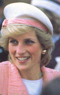 DIANA. Excepting the color, this hat reminds me of a French Navy style. The pink band really ties it to her jacket.