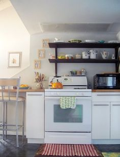 20 Small, Black and White Kitchens That Prove This Classic Combo Is Always In Style Bar Seating, Wall Spaces, Apartment Therapy, Home Kitchens, Kitchen Cabinets, Black And White, Interior Design, Cool Stuff, Furniture