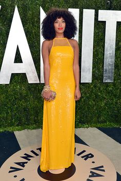 Solange Knowles in an Emilio Pucci yellow beaded gown with a mesh halter neck at the Vanity Fair Oscar party