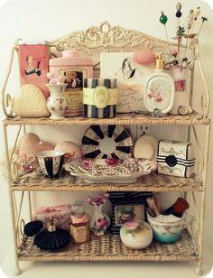 Shelf with vintage pretties in bathroom...shabby chic, French, cottage, romantic, black & pink, glamour, girly