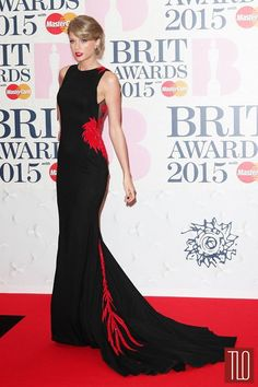 Taylor Swift attends the 2015 BRIT Awards at The O2 Arena in London in a custom Roberto Cavalli gown.