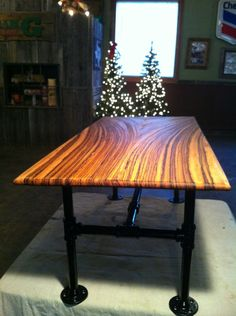 Table made from zebra wood and galvanized piping table by my husband