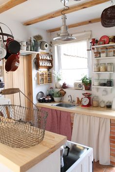 Tiny kitchen with cabinet curtains and open shelving