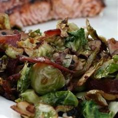 Shaved Brussels Sprouts with Bacon and Almonds Recipe - Brussels Sprouts are shredded like cabbage and quickly sauteed in bacon drippings with garlic and almonds. This recipe has made Brussels sprouts lovers out of haters. Shaved Brussel Sprouts, Brussels Sprouts, Sprout Recipes, Vegetable Recipes, Bacon Fried Cabbage, Sprouts With Bacon, Roasted Sprouts, Cooking Recipes, Healthy Recipes