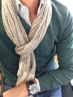 green v neck sweater. green pinstriped oxford. jeans. scarf. watch. bracelets. comfortable. casual. smart. style.