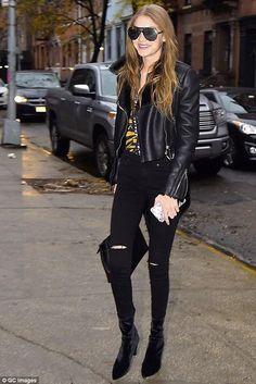 Gigi Hadid wearing Mansur Gavriel Lady Bag, Stuart Weitzman Nero Stretch Velvet Clinger Booties and Gucci Blooms Iphone Case