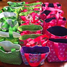 I used a super easy tutorial, which is pinned to make these favor bags for my little lady's birthday party. They were filled with hand sanitizer from bath and body works, lip smackers and ring pops!  <3 them!