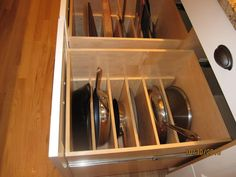 Drawers with slots for individual pans. LOVE.