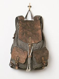 Missoula Backpack | Canvas backpack with leather detail. Two front utility…