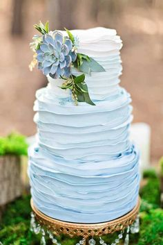 """Blue is one lucky color when it comes to the wedding day. And for that reason, we're channeling the positive energy with these gorgeous """"something blue"""" wedding cakes! See some of the fanciest, cool blue cakes below for some sweet inspiration. Chandelier Cake, Chandelier Crystals, Something Blue Wedding, Buttercream Wedding Cake, Buttercream Ruffle Cake, Buttercream Ideas, White Frosting, Cake Fondant, Blue Cakes"""