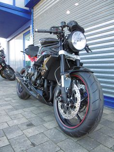 3/4 view of our Street Triple Cafe Racer special.