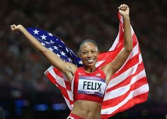 Allyson Felix celebrates after winning gold in the Women's 200m Sprint