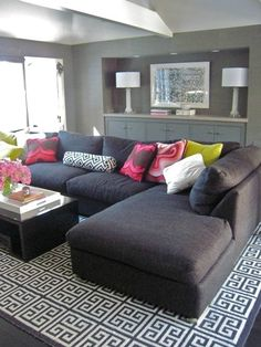modern gray living room design with charcoal gray sectional sofa and Jonathan Adler black Greek key rug by Brenda Olmsted.