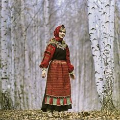 Festive girl's costume of the village Kochetovka Nizhnedevitinskogo County Voronezh (dress made of black woolen cloth, with a red shirt and red vorotushkoy sleeved woven with colored ornaments and embroidery, red apron with a woven white pattern, red headscarf). End of XIX - early XX century. Voronezh Regional Museum.