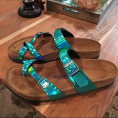Metallic turquoise Birkenstocks! These Birkenstock Mayari babies are awesome. Metallic turquoise straps, padded birko-sole, put on about once in my life around the house. In new new new condition. And the wrap around toe is so cute! Birkenstock Shoes Sandals
