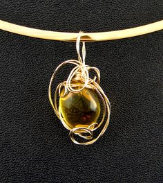 Mosqito is trapped inside the amber. Wrapped in gold wire. My Wife Is, Gold Wire, Lost & Found, Jurassic Park, Amber, Studios, Stones, Jewelry Design, Candy