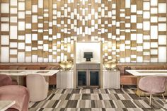 The space is dotted with custom-made fixtures and furnishing, including suspended brass lanterns hanging in space, beautifully contrasting wall, ceiling and floor mosaics that mimic Dubai's dynamic skyline.