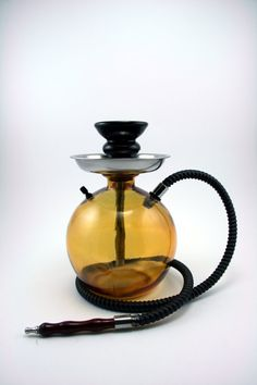 Hookah Custom Shisha Bottle With Matching Hose, Tray, and Bowl Gold Yellow. $49,99, via Etsy.