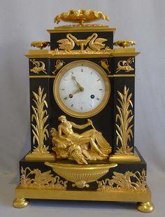 Antique French Empire clock in ormolu and patinated bronze celebrating Poseidon. - Gavin Douglas Antiques