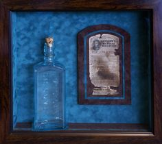 "Customer of ours was doing some construction on his home and found ""Kennedy's Medical Discovery"" bottle in his attic. The bottle is from the mid to late 1800's. The frame is wide enough to sit on a shelf, or it can be hung on a wall."