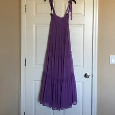 "Bebe Lavender tube top maxi dress Worn once in great condition beside a few pulls but not too noticeable as pictured. May be worn as a tube top maxi with ties tucked inside or even high waisted dress. Measures approx 46"". Selling as is, all sales final. bebe Dresses Maxi"