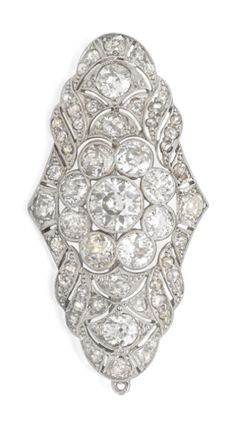 *DIAMOND BROOCH, CIRCA 1930  The lozenge-shaped open work plaque centring a flowerhead cluster millegrain-set with old European-cut diamonds framed by similarly set rose, old mine and old European-cut diamonds, the diamonds together weighing approximately 5.12 carats, mounted in 18ct white gold, approximately 45 x 25mm.