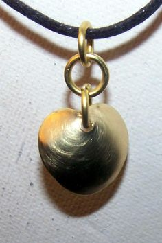 18 mm brass heart, hand pierced from brass sheet, then domed and finished. The three rings to suspend the heart were made from 16 gauge brass wire, hand wrapped, sawn and burred to round the ends and remove sharp edges.
