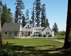 Modern farmhouse but cozy, love the windows & fireplace exterior.