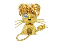 A Gem-Set and Gold Lion Brooch, Fred « Dupuis Fine Jewellery Auctioneers