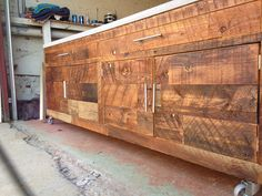 reclaimed wood and concrete topped storage cabinet by naan industries