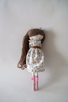 Meet Isabella!    She is an adorable doll, ooak, with a babydoll dress, light pink socks with pompoms and bow!!  She is 10 inches (26 cm)