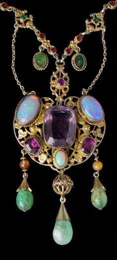 Necklace Gilded silver Amethyst Opal Emerald Agate Paste Pendant: H: 10 cm (3.94 in) W: 4.8 cm (1.89 in) Necklace: L: 50 cm (19.68 in) Marks: Dogs head & 'WM' Austro-Hungarian, c.1900 Literature: cf. European Designer Jewellery, Ginger Moro, 1995, p. 175-179