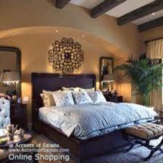Mediterranean bedroom - wood headboard and iron wall accent above, guest suite
