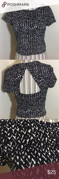 Black and White New Express Crop Top Open Back Brand New with tags super cute shirt! Has a nice cut out on the back! Size Small Express Tops Crop Tops