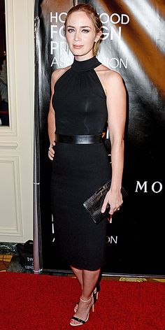 Last Night's Look: Love It or Leave It? Vote Now!   EMILY BLUNT   wearing a sleek black Michael Kors Collection halter dress, EF Collection earrings, two-tone Casadei sandals and a Milly clutch at the HFPA Annual Grants Banquet in Beverly Hills.