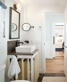 wood counter and backsplash- love the light, mirror, curtained sink vanity, and white walls