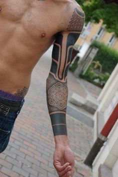 Full sleeve tattoo, geometric designs.