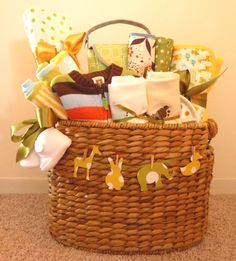 Baby gift basket! Look at the tiny clothes pins holding the little animals! So great. I will have to do two baskets for twin boys.