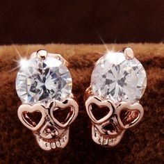 Skull Studs Cute little 18k gold plated zinc alloy earrings with CZ stone. Soooooo cute! New in package. Jewelry Earrings