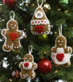 These Gingerbread Family Crochet Christmas Ornaments crochet patterns include a family of gingerbread ornaments with their sweet little gingerbread house, too. By far, some of the cutest Christmas ornament crafts that crocheters can make. Crochet Christmas Decorations, Crochet Decoration, Crochet Ornaments, Christmas Crochet Patterns, Holiday Crochet, Christmas Knitting, Crochet Crafts, Free Crochet, Easy Crochet