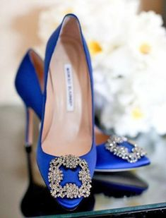 Manolo Blahnik Hangisi pumps The wedding shoe of two legendary fashionistas: Carrie Bradshaw and Olivia Palermo. Manolo Blahnik ($965) Read more: 10 Iconic Shoes That Are Still Going Strong | PureWow National Sign Up For PureWow's Daily Email #manoloblahnikcarrie #manoloblahnikwedding