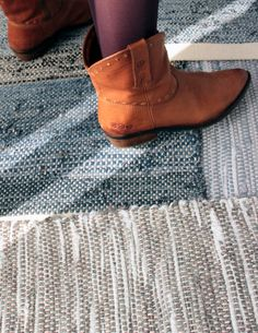 Detail of some re:loom rugs (I shot this photograph at a vignette photo shoot) and photographer Christina Wedge's cowboy boots :)