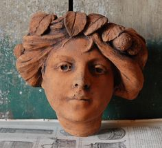 A terracotta face planter,