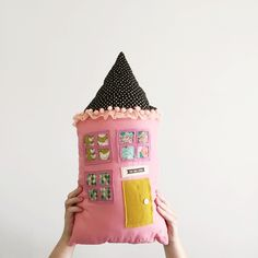 """Handmade fabric doll housemade with designer cotton fabrics and wool felt.Each pillow is handmade and made with lots of love. Buyer can choose the front color of the house. Each house has a fun pattern backing that matches the front color.Tag above door says """" you are loved"""" or """"hello friend""""Size: 20x11House pillows will ship within 3 weeks of purchaseCOLORS: PINK ( shown in above photo) CORAL and YELLOW/GOLDPillows in last photo are..."""