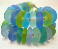 50 Handmade Etched Lampwork Beads Disk Shaped Ocean Mix SRA. $20.00, via Etsy.