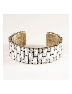 J. Crew. Burnished gold is juxtaposed with sparkling jewels to create a perfectly contradictory piece. Emerald cut stones provide the vintage, classic vibe, which is countered by antiqued gold so the gems don't steal the whole show. Beautiful.